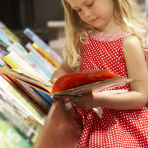 child reading a book in a bookstore
